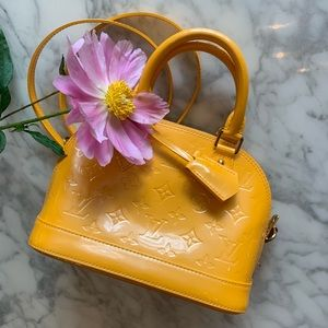 "Mint condition Louis Vuitton Alma BB in ""mango"""